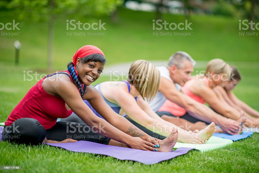Stretches During Outdoor Yoga Class stock photo