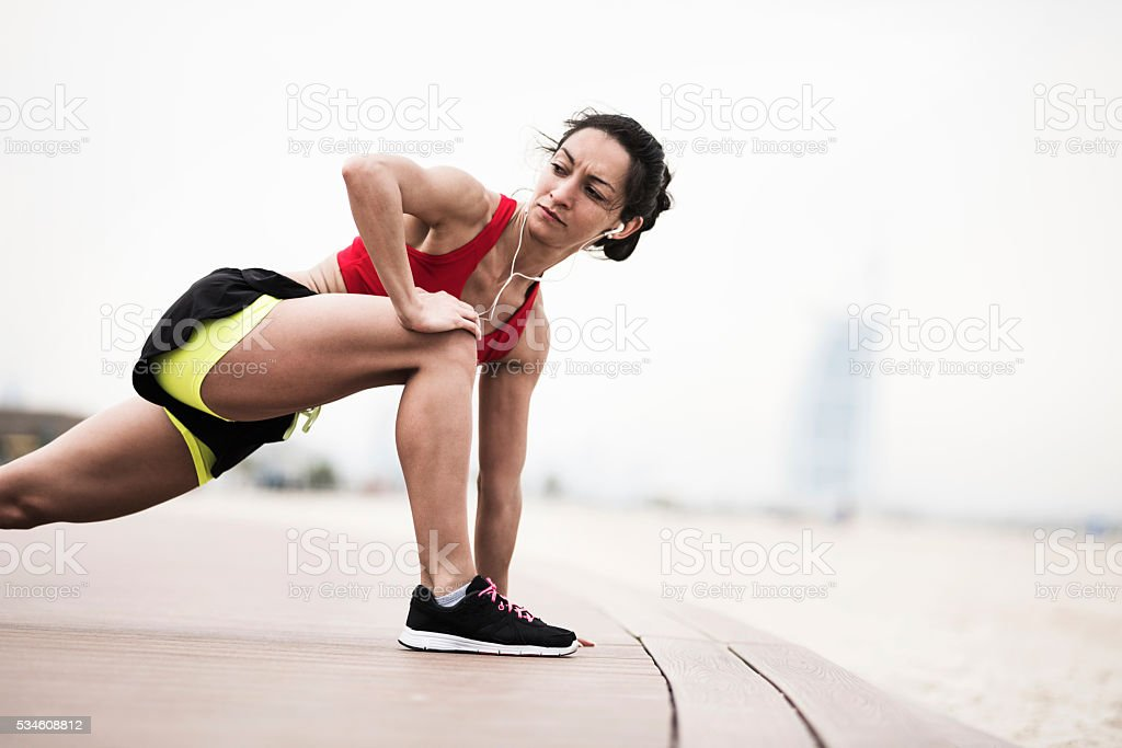 Stretching after running stock photo
