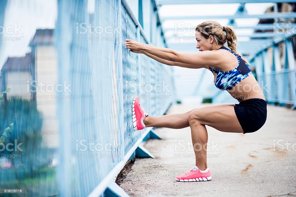 Stretching after workout stock photo