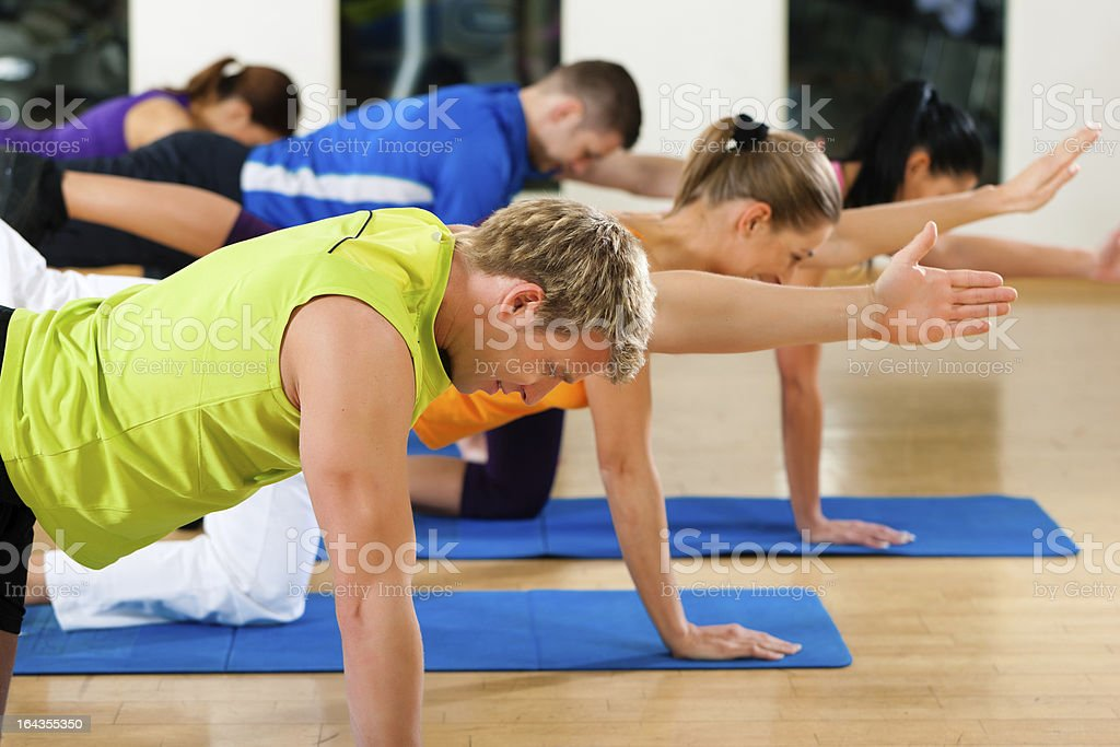 Stretching and gymnastics in fitness club or gym royalty-free stock photo