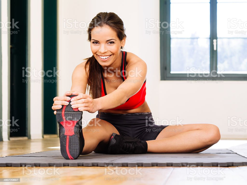 Stretching and warming up in the gym stock photo