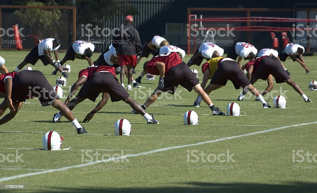 Stretching at Football Practice royalty-free stock photo