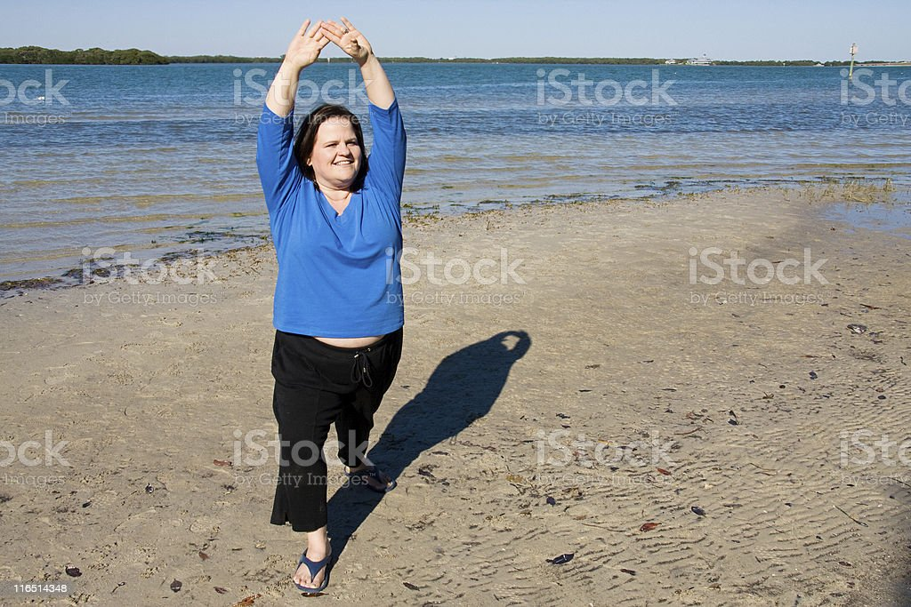 Stretching at the Beach royalty-free stock photo
