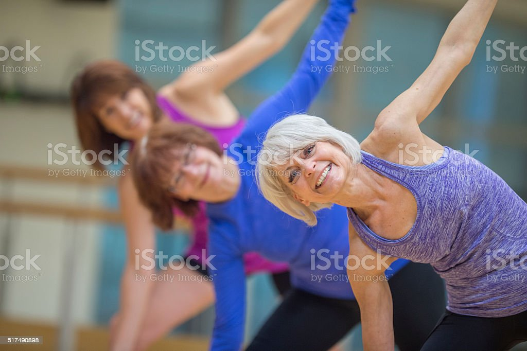 Stretching at the Gym stock photo