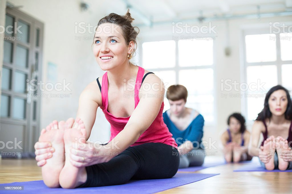 Stretching at yoga class stock photo