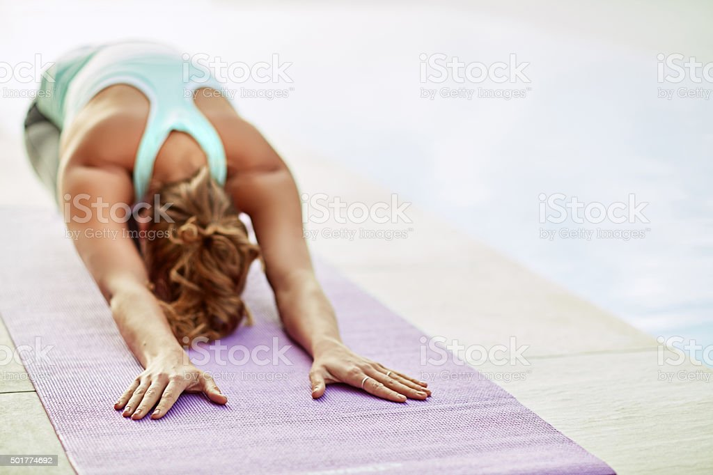 Stretching away the stress stock photo