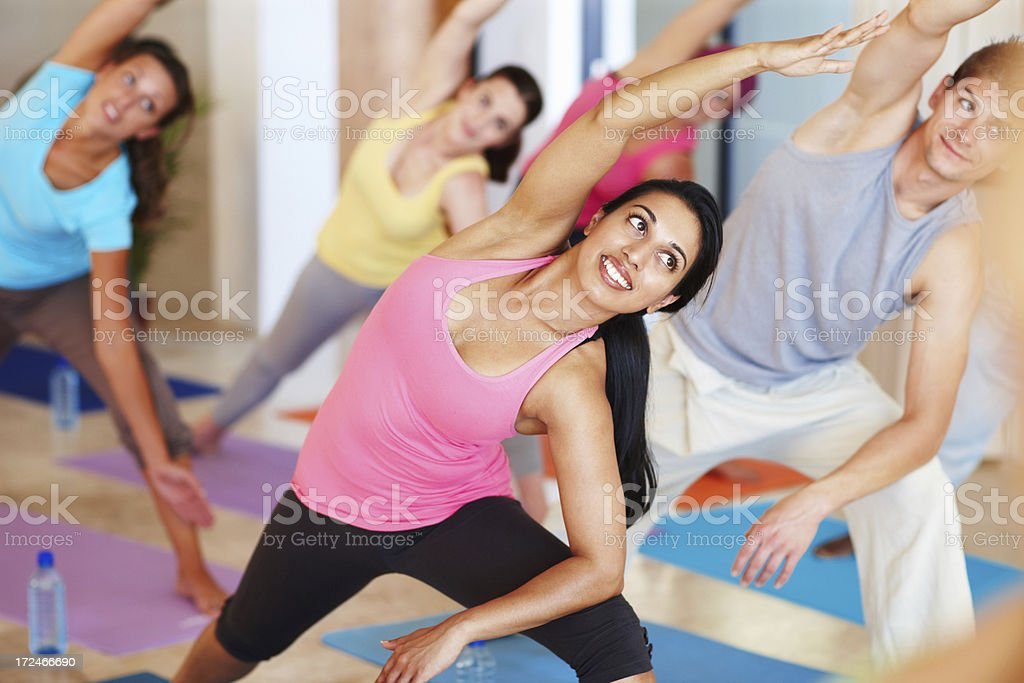 Stretching away to fitness royalty-free stock photo