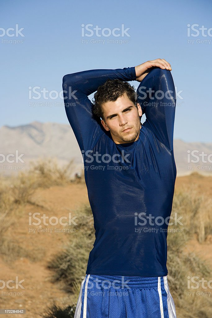 Stretching before a workout royalty-free stock photo