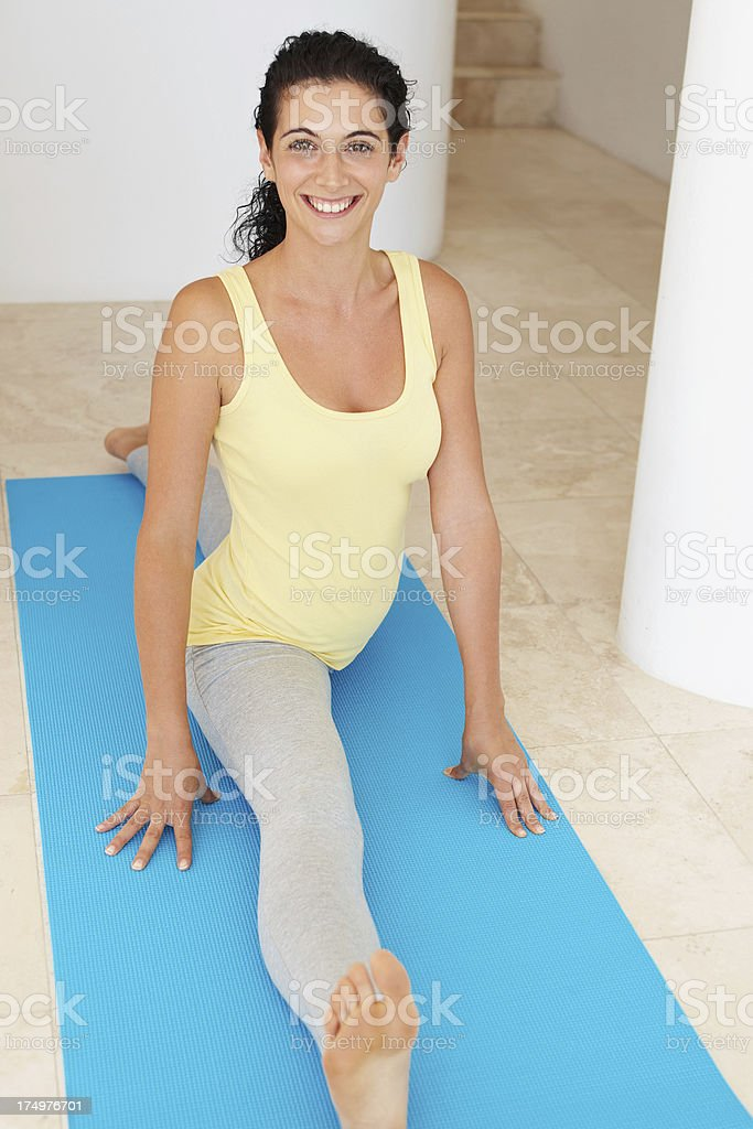 Stretching before her workout royalty-free stock photo