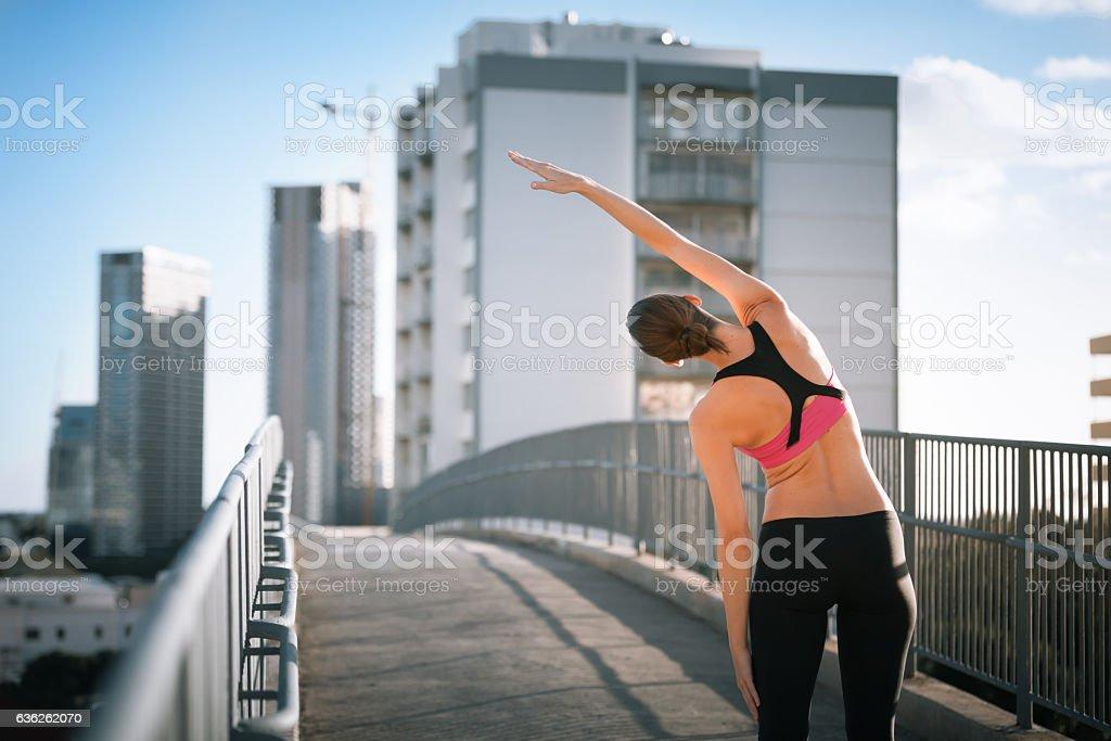 Stretching before the run stock photo