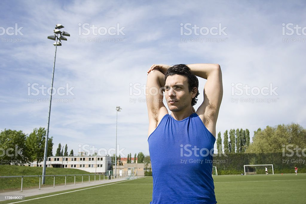 Stretching Before Working Out royalty-free stock photo