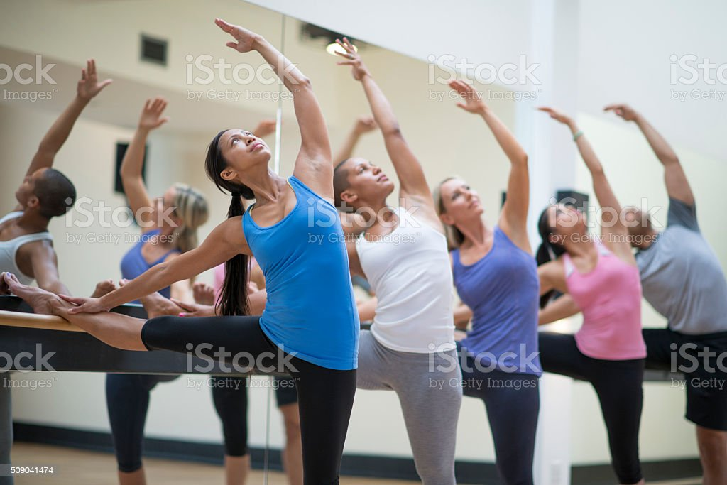 Stretching During a Barre Class stock photo