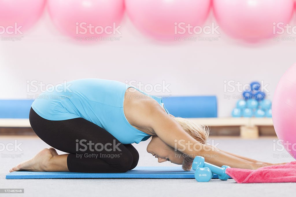 stretching during pilates royalty-free stock photo