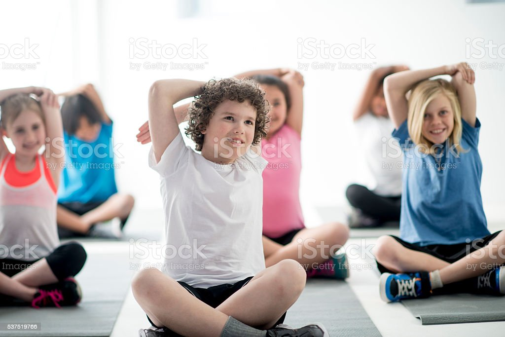 Stretching During Yoga Class stock photo