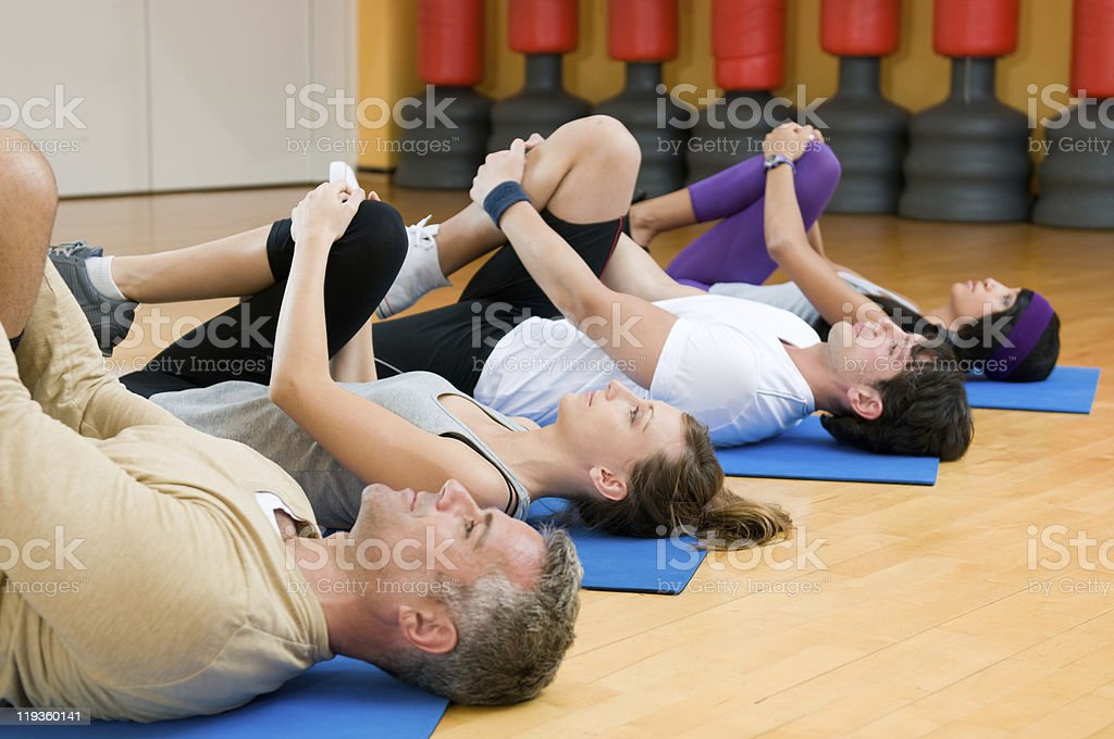 Stretching exercises at gym stock photo