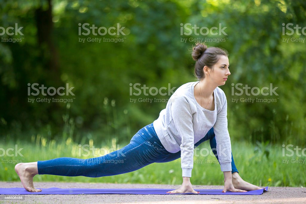 Stretching exercises in park alley stock photo