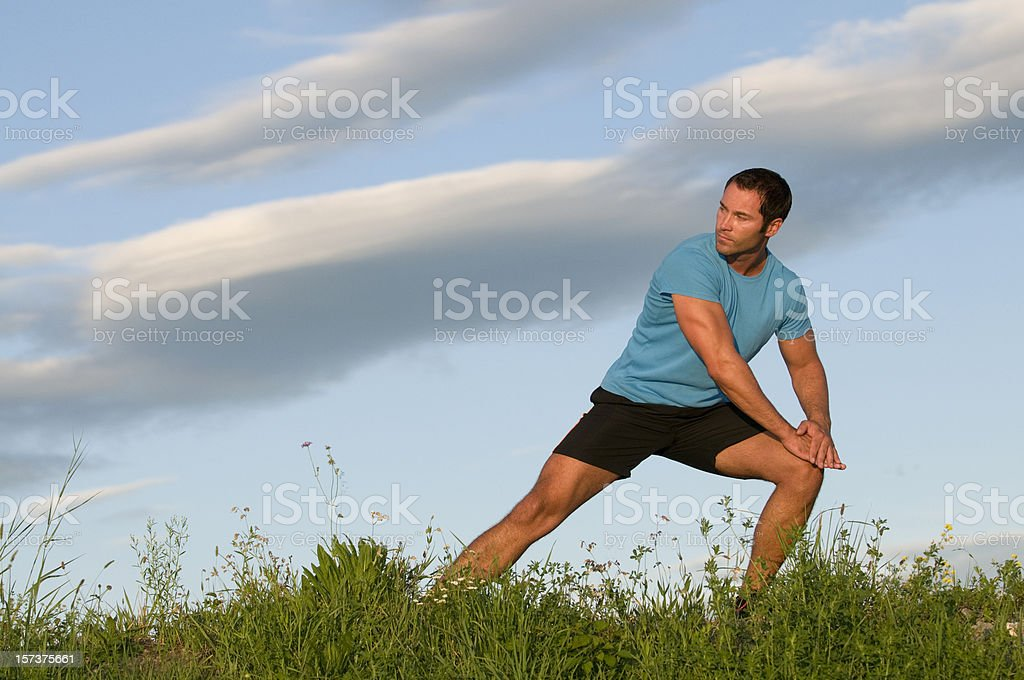 stretching exercises in the grass royalty-free stock photo