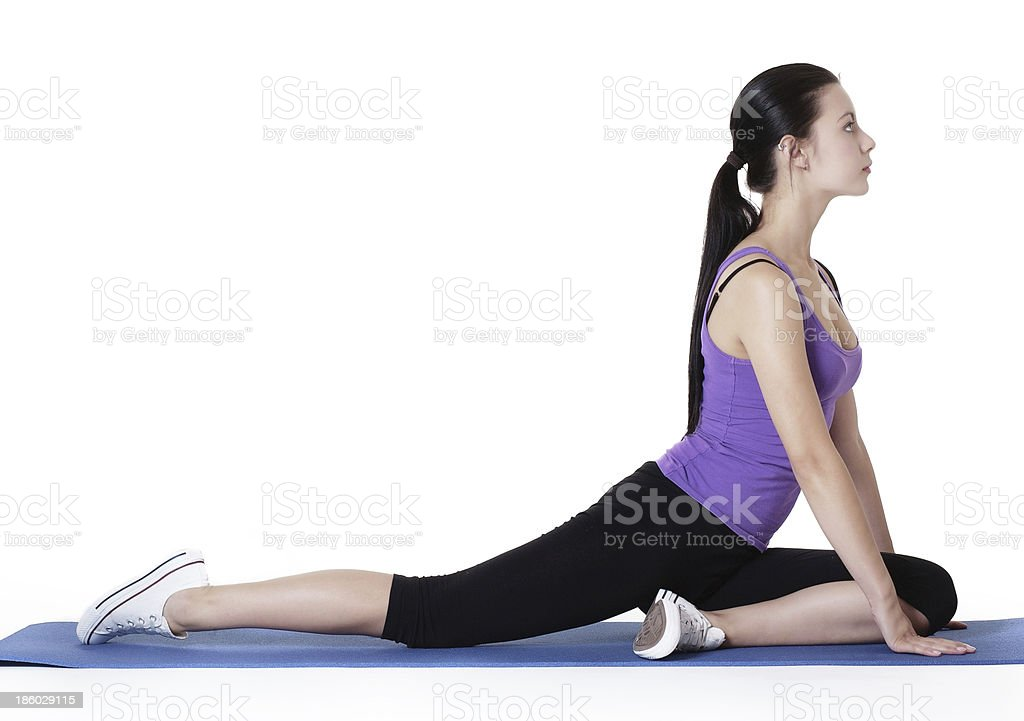 stretching exercises on a mat royalty-free stock photo