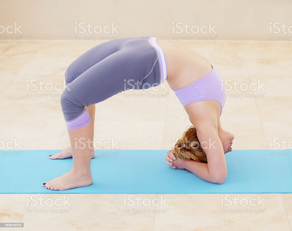 Stretching her back muscles royalty-free stock photo