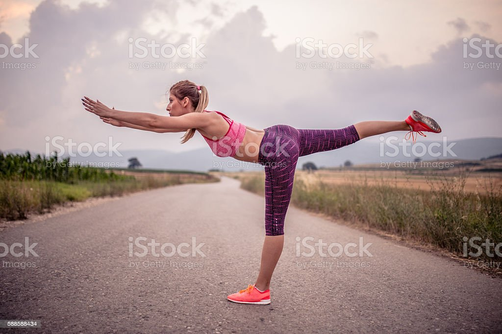 Stretching her body stock photo