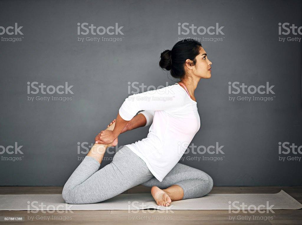 Stretching her glutes stock photo
