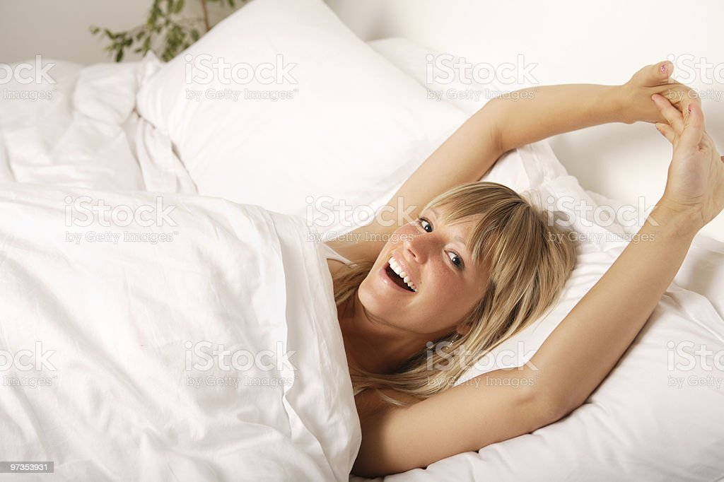 Stretching in bed royalty-free stock photo