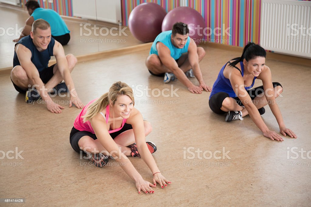 Stretching in fitness club stock photo