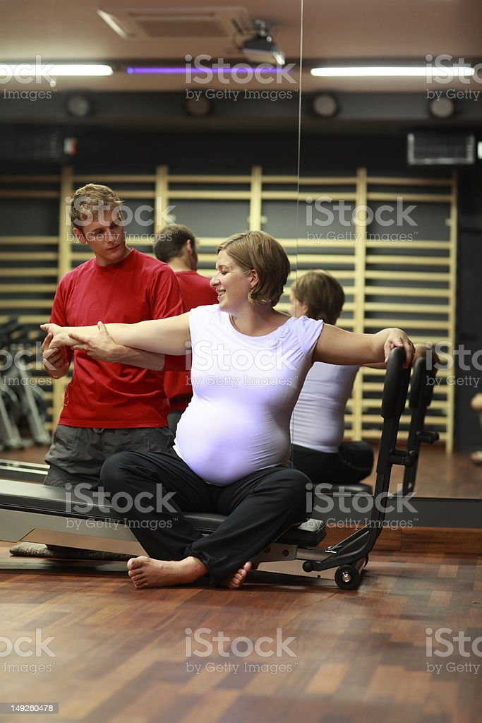 Stretching in pregnancy with physical therapist stock photo
