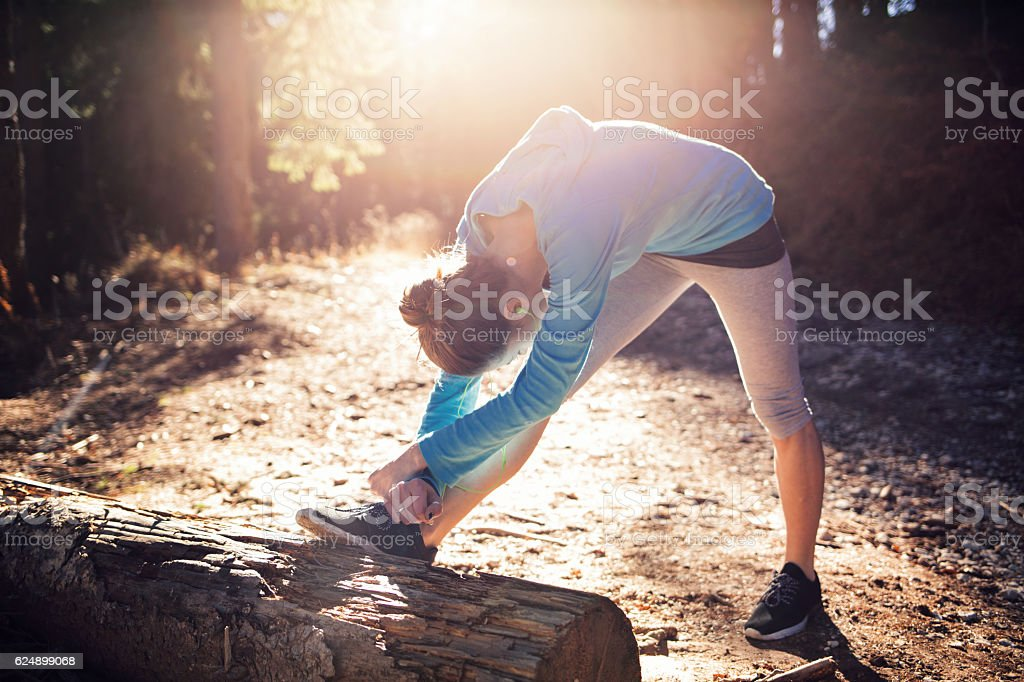 Stretching in the forest stock photo