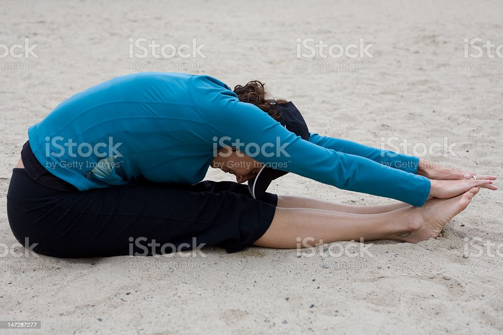 Stretching in the sand royalty-free stock photo