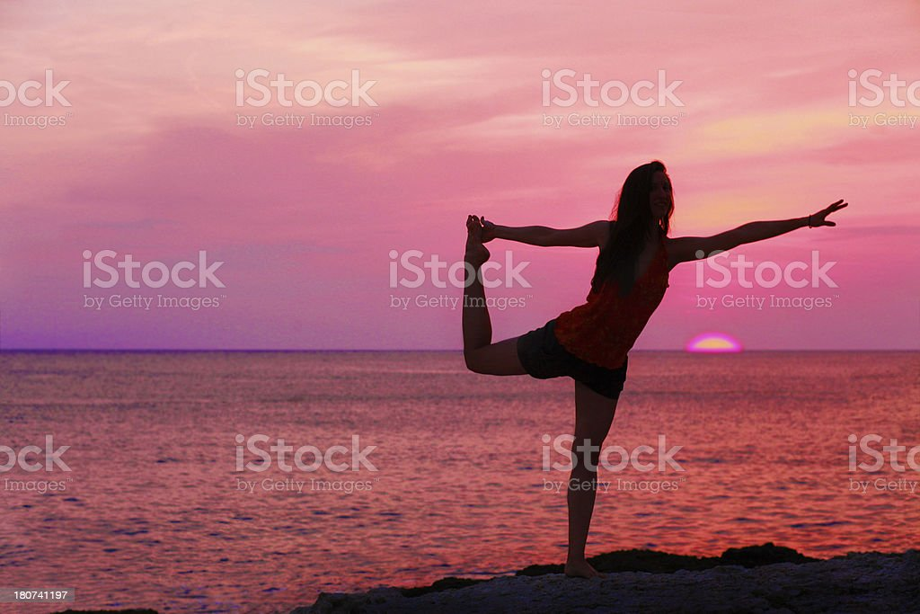 Stretching in the sunset after yoga practice royalty-free stock photo