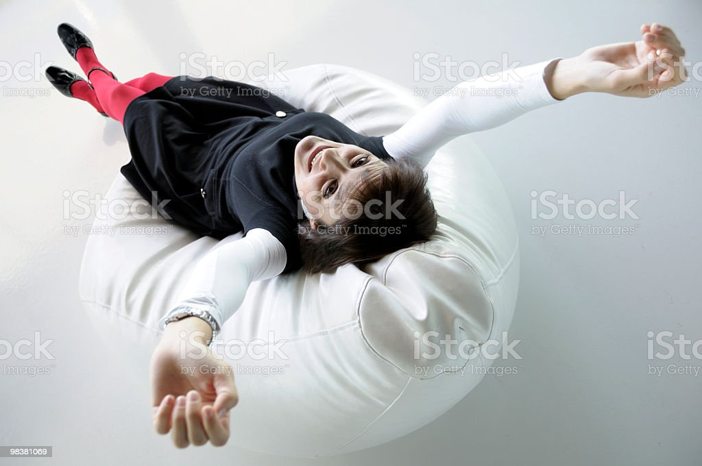 Stretching on a Bean Bag royalty-free stock photo