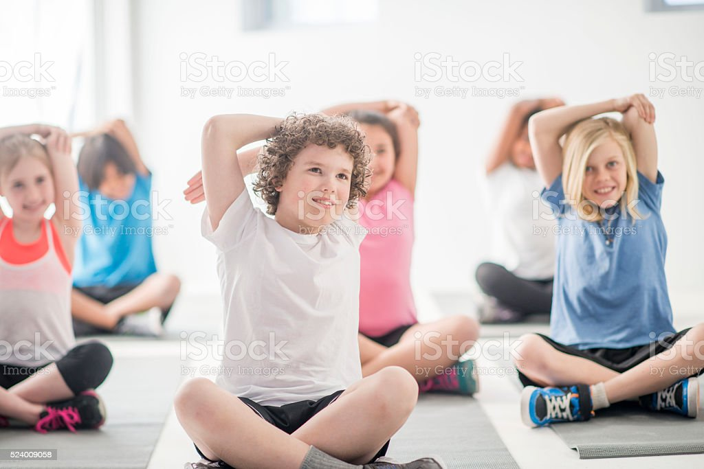 Stretching on a Yoga Mat stock photo