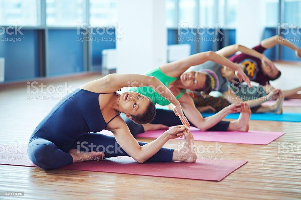 Stretching on mats stock photo