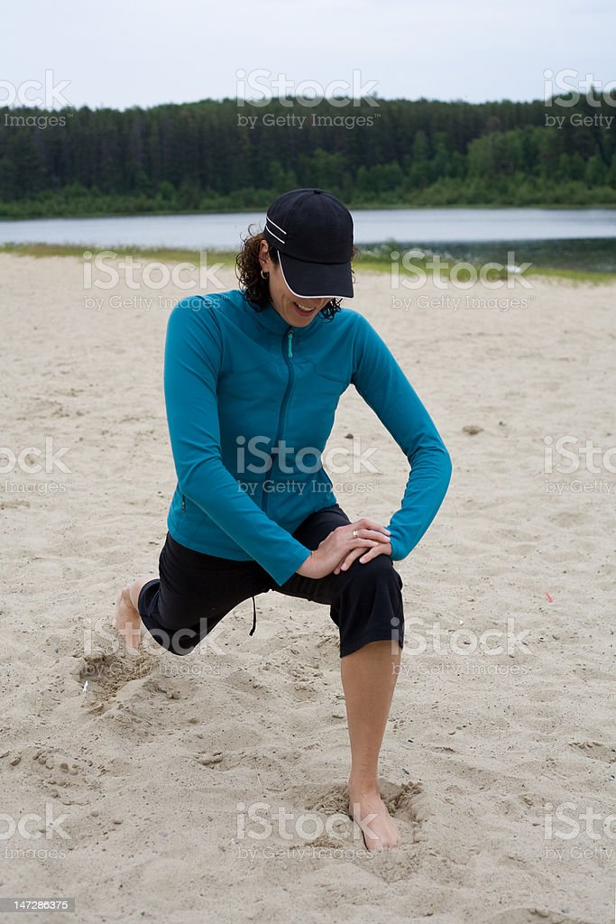 Stretching on the beach royalty-free stock photo