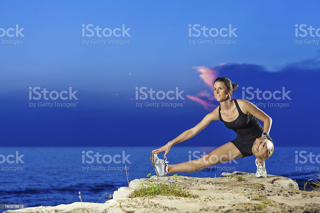 stretching on the edge royalty-free stock photo