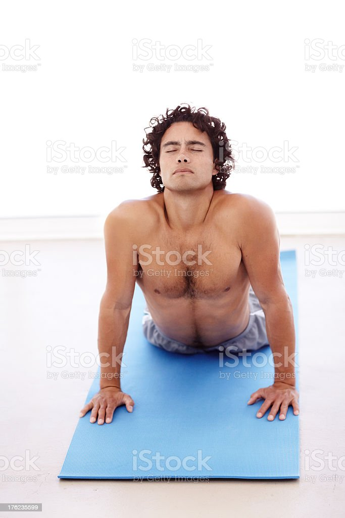 Stretching out his lower back stock photo
