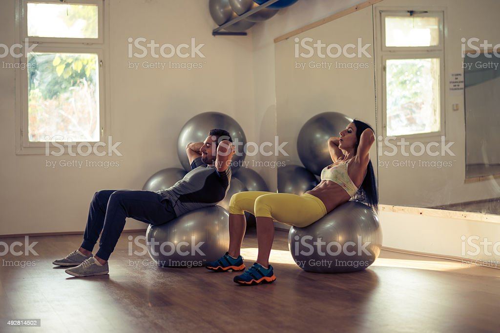 Stretching out those knots stock photo