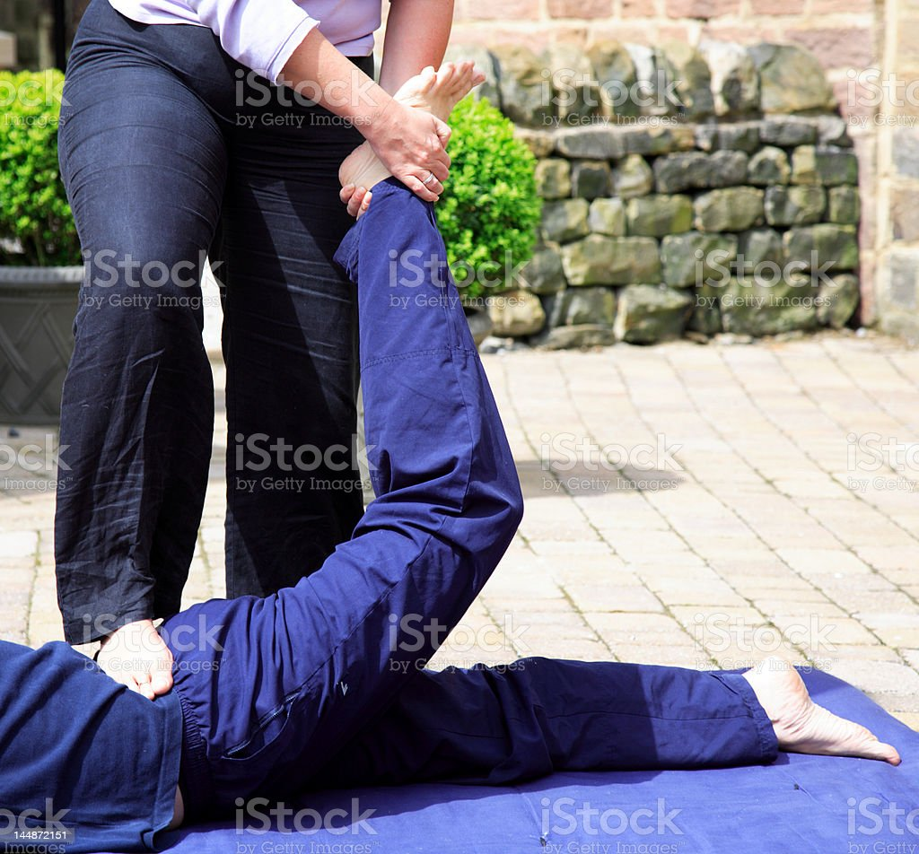 Stretching the lower back royalty-free stock photo