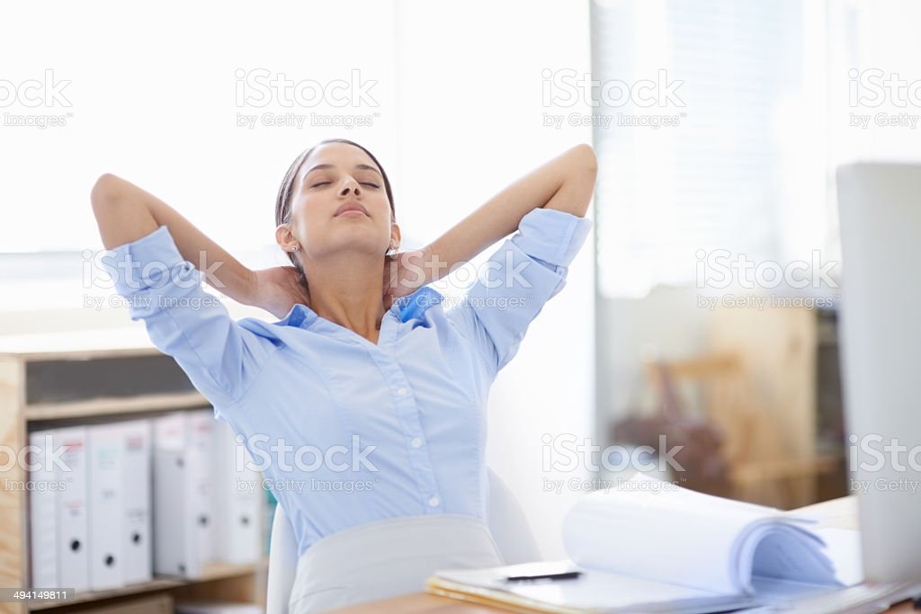 Stretching those tight neck muscles stock photo
