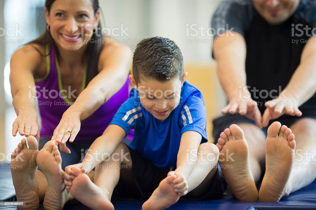 Stretching to Reach Their Toes stock photo