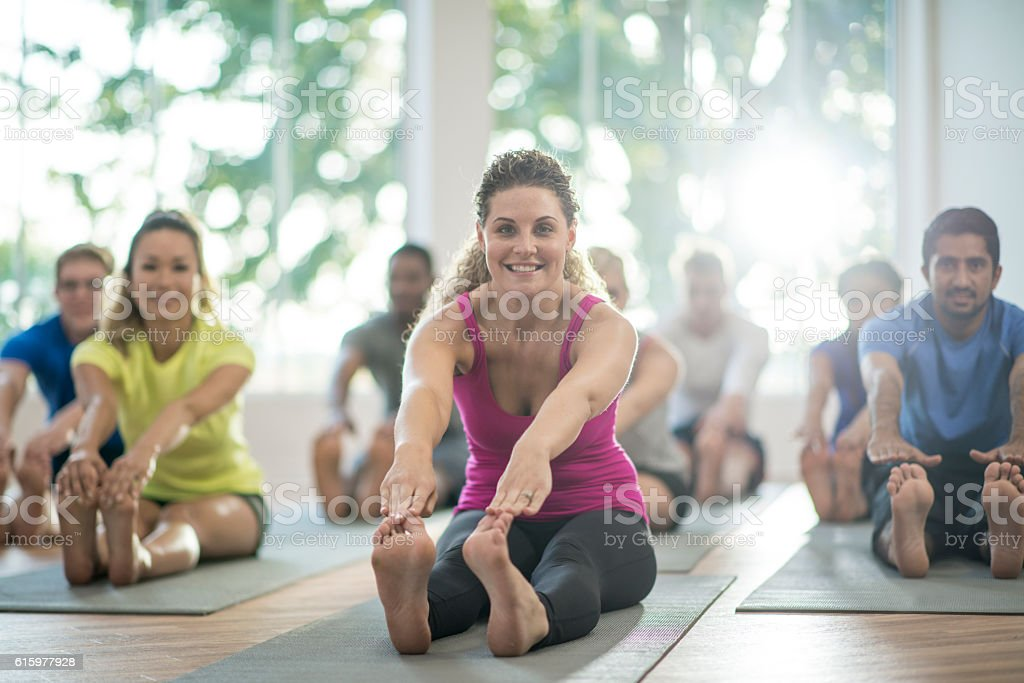 Stretching to Their Toes stock photo