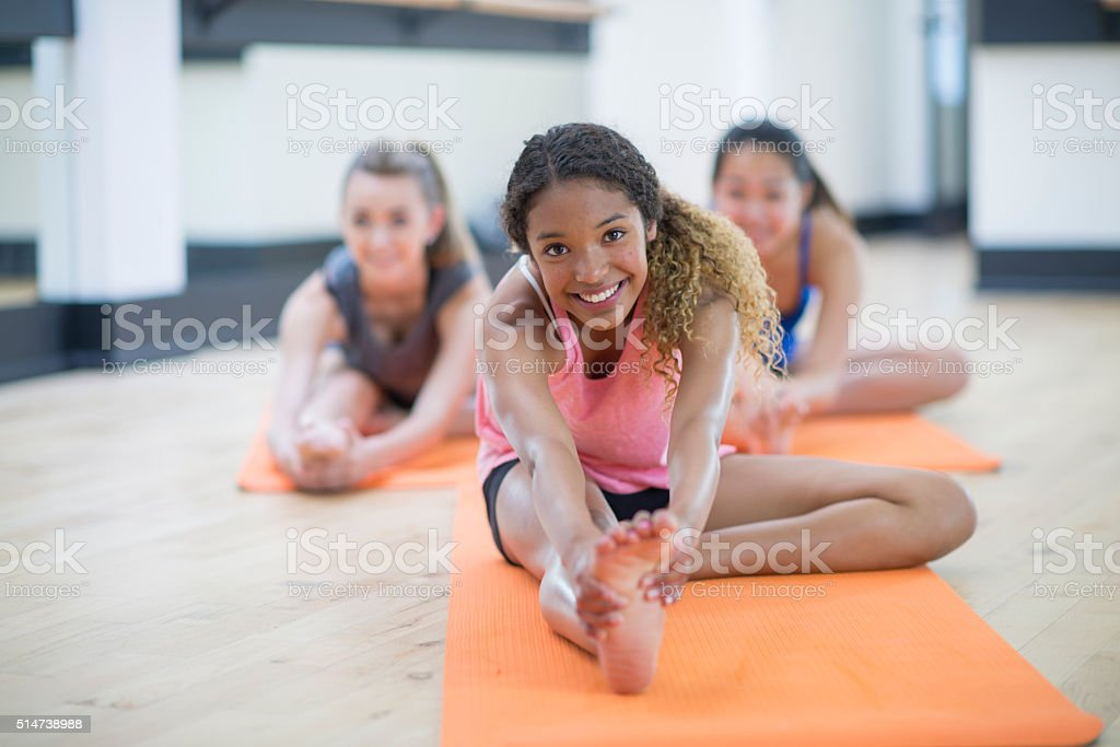 Stretching to Touch Their Toes stock photo