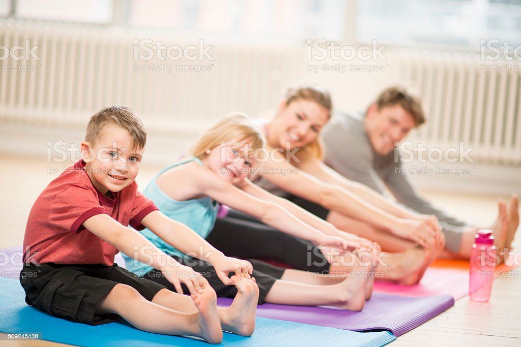 Stretching Together as a Family stock photo