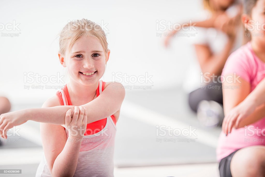 Stretching Together in Yoga Class stock photo