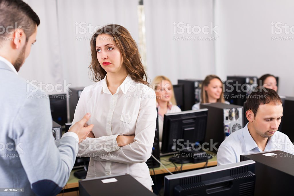 Strict boss and crying clerk stock photo