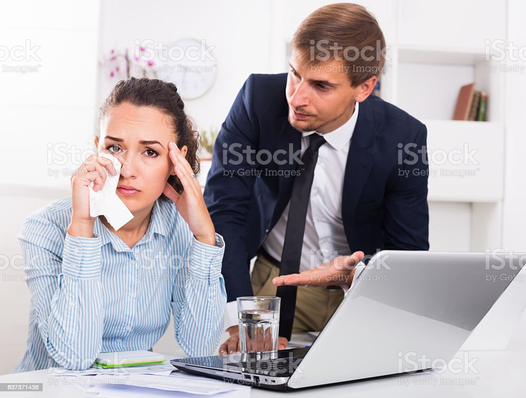 strict boss man accusing crying woman in firm office stock photo
