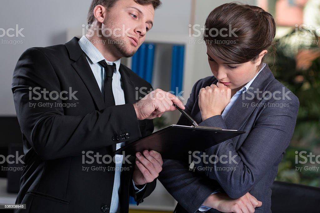 Strict boss talking with secretary stock photo