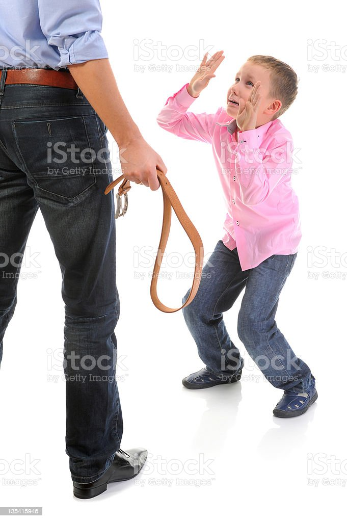 Strict father punishes his son royalty-free stock photo