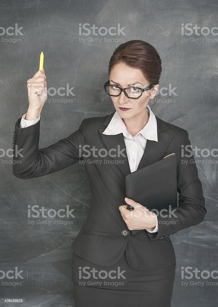 Strict teacher with chalk and folder royalty-free stock photo